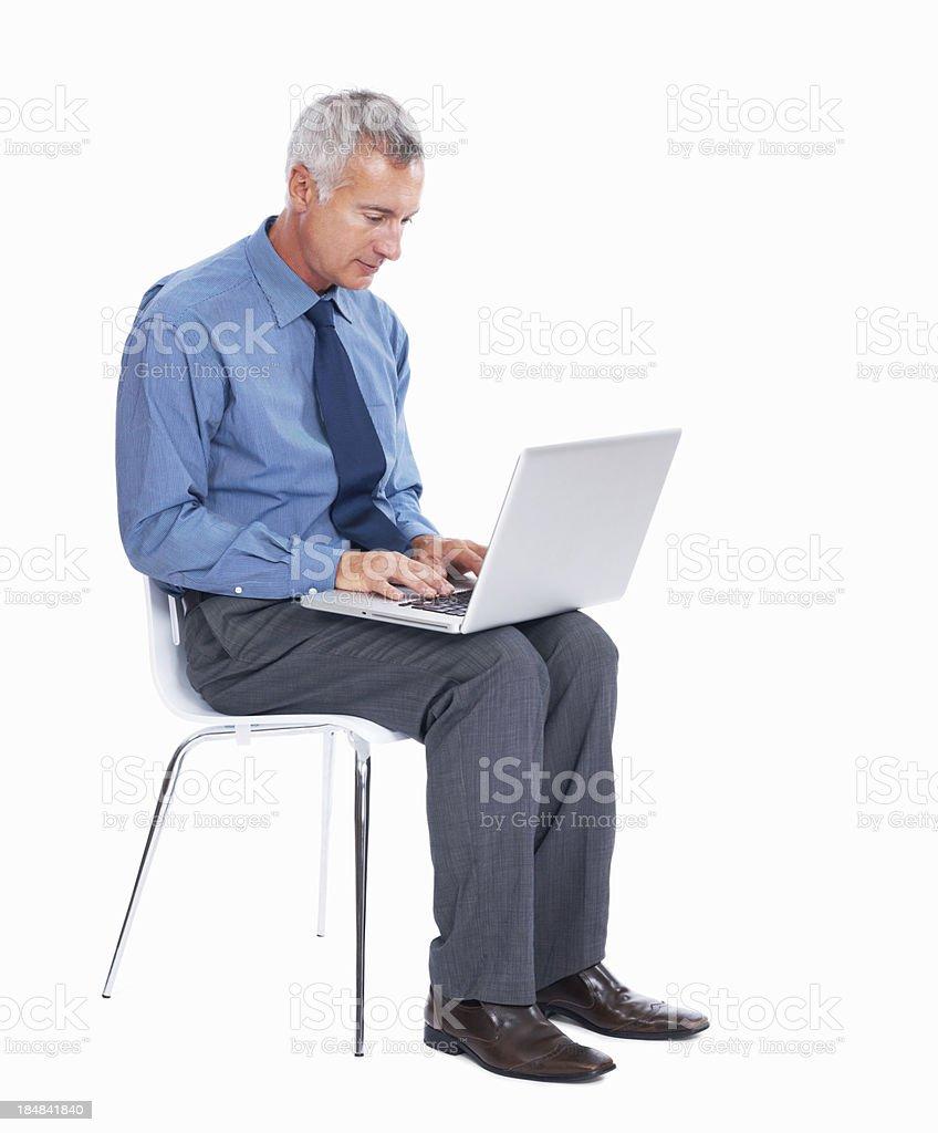 Executive working on laptop royalty-free stock photo