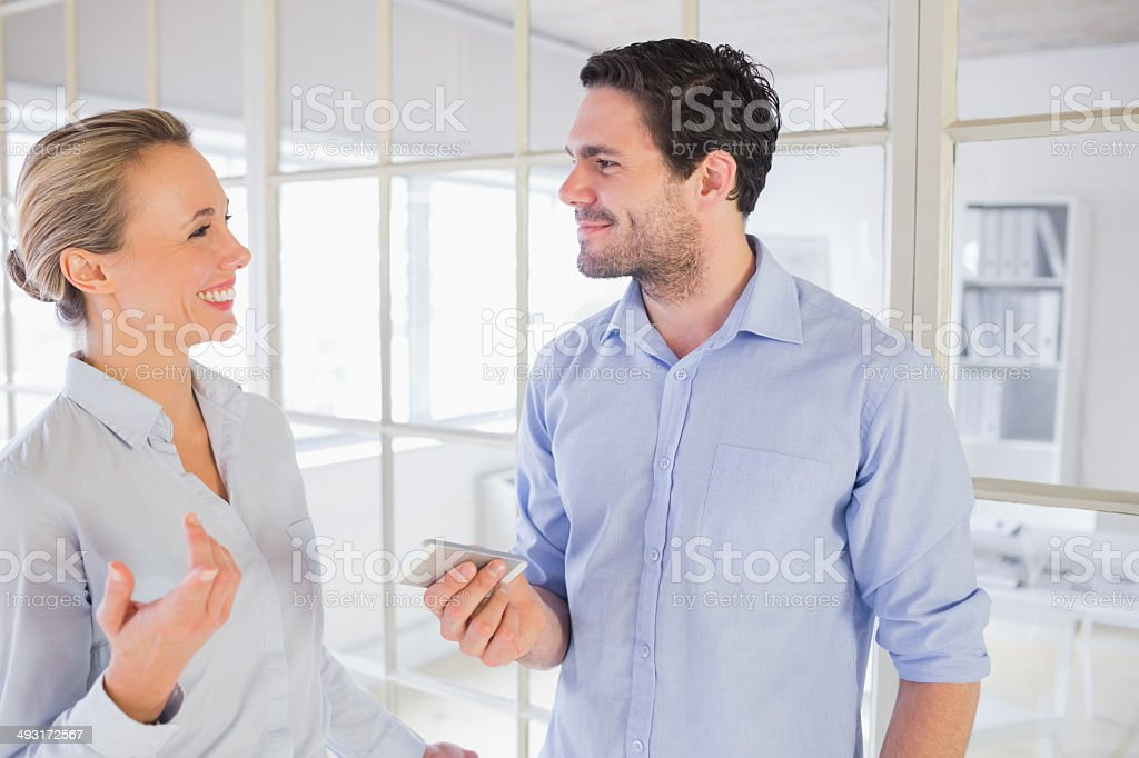 Executives chatting during office break stock photo