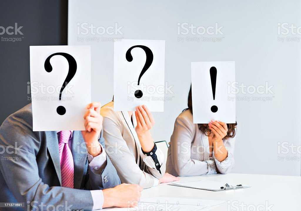 Executives covering their faces with different signs royalty-free stock photo
