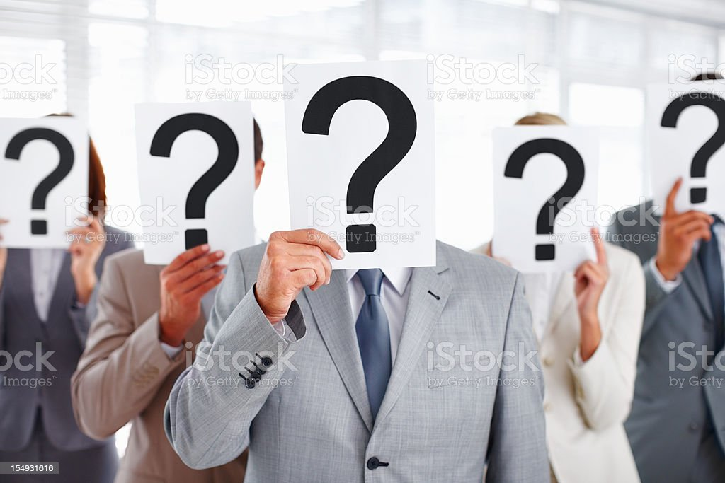 Executives covering their faces with question mark royalty-free stock photo