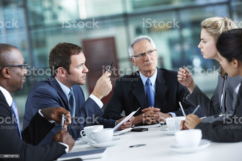 Executives discussing during meeting stock photo