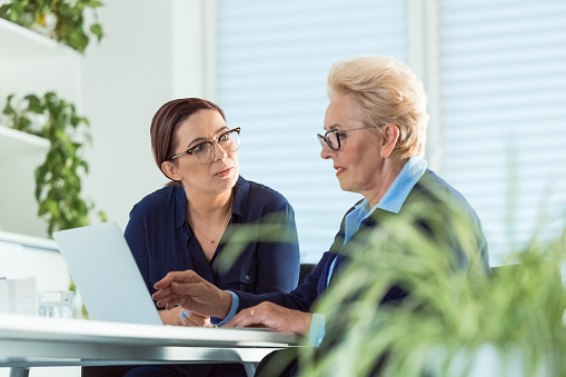 Executives Discussing Over New Business Projects Stock Photo - Download Image Now