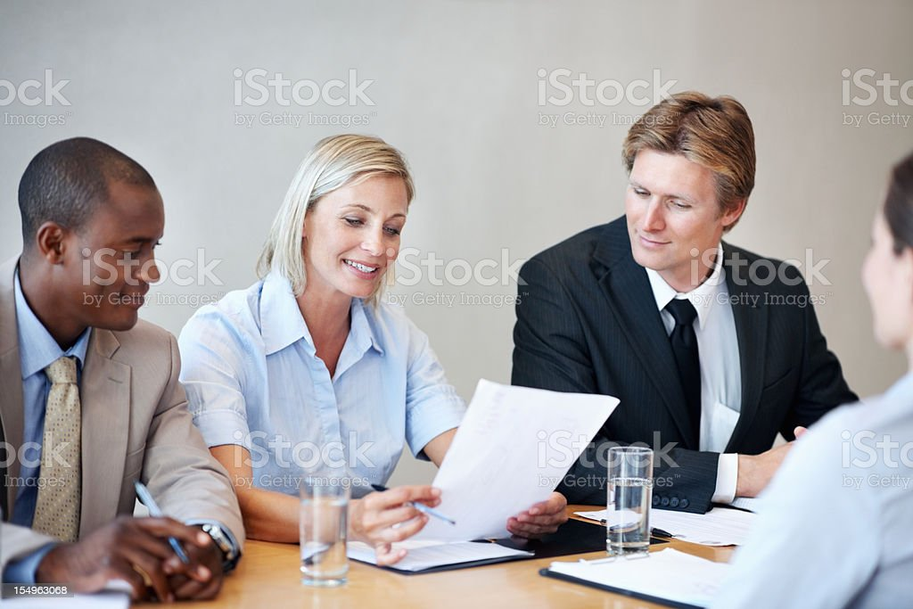Executives going through the CV and smiling royalty-free stock photo