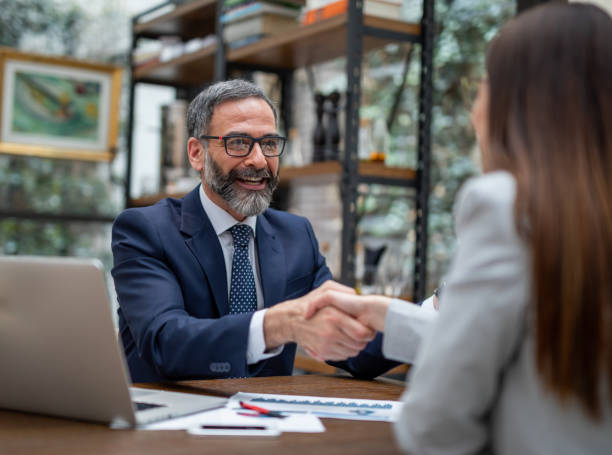 Executives handshaking in a coffee shop stock photo