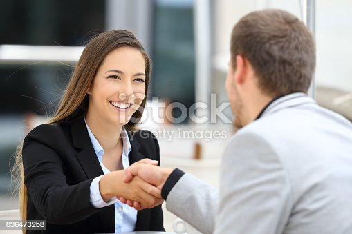 istock Executives handshaking in a coffee shop 836473258