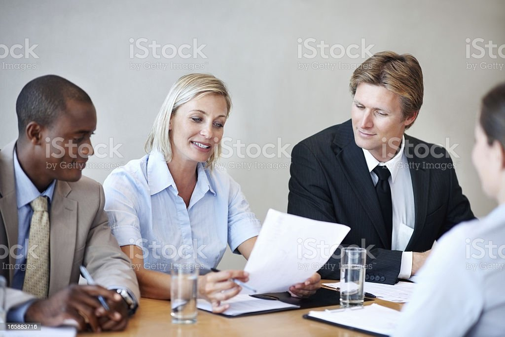 Executives reading the resume of an applicant Panel of executives reading the resume of an applicant during her interview 20-29 Years Stock Photo