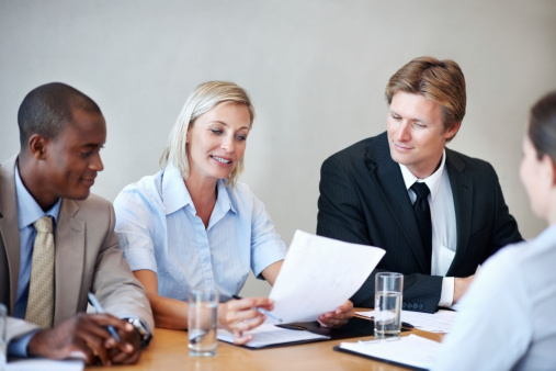 Executives Reading The Resume Of An Applicant Stock Photo - Download Image Now
