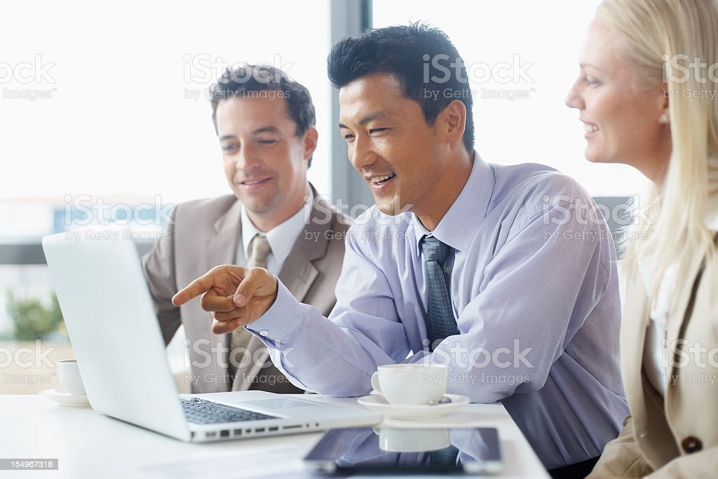 Executives reviewing project on laptop royalty-free stock photo