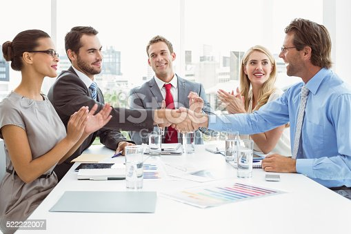 istock Executives shaking hands in board room meeting 522222007