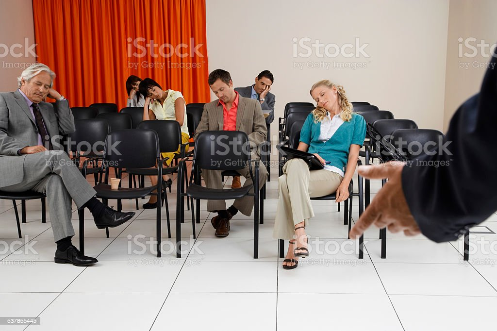 Executives Sleeping During Seminar stock photo