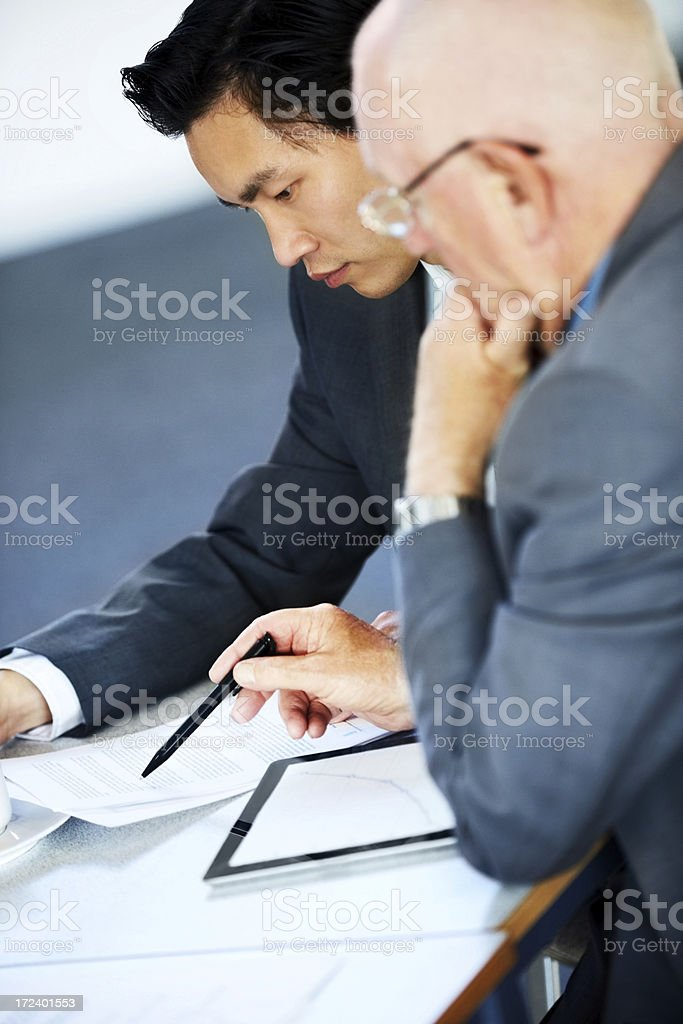 Executives viewing new business proposal royalty-free stock photo