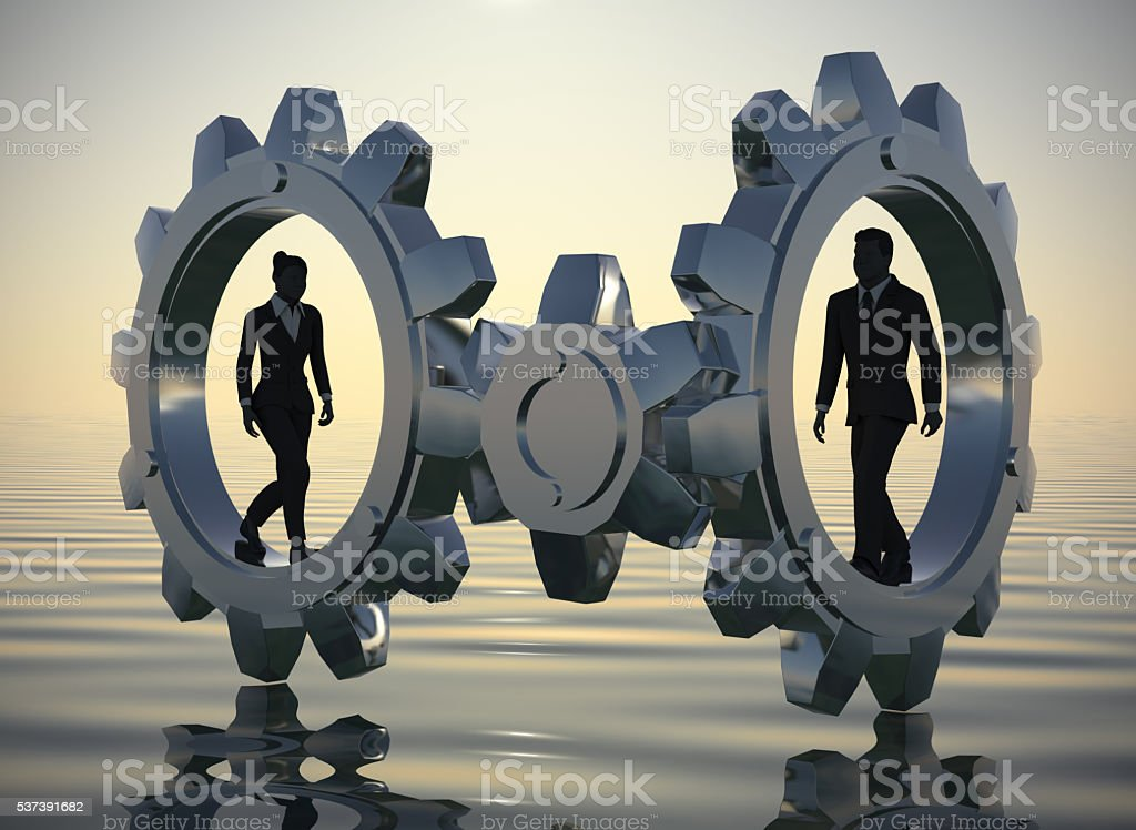 Executives walking inside gears at sea since dawn. stock photo