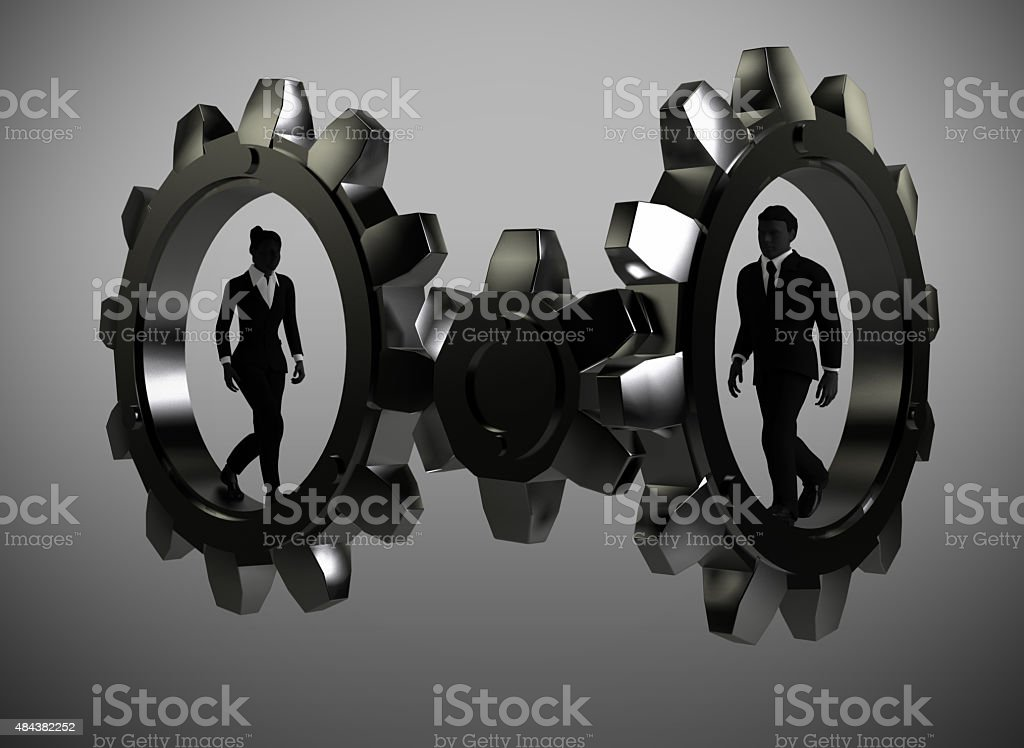 Executives walking inside metal gears. stock photo