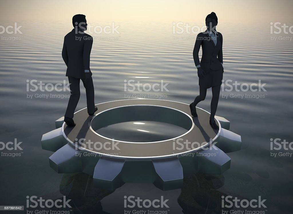 Executives walking on a gear at sea since dawn. stock photo