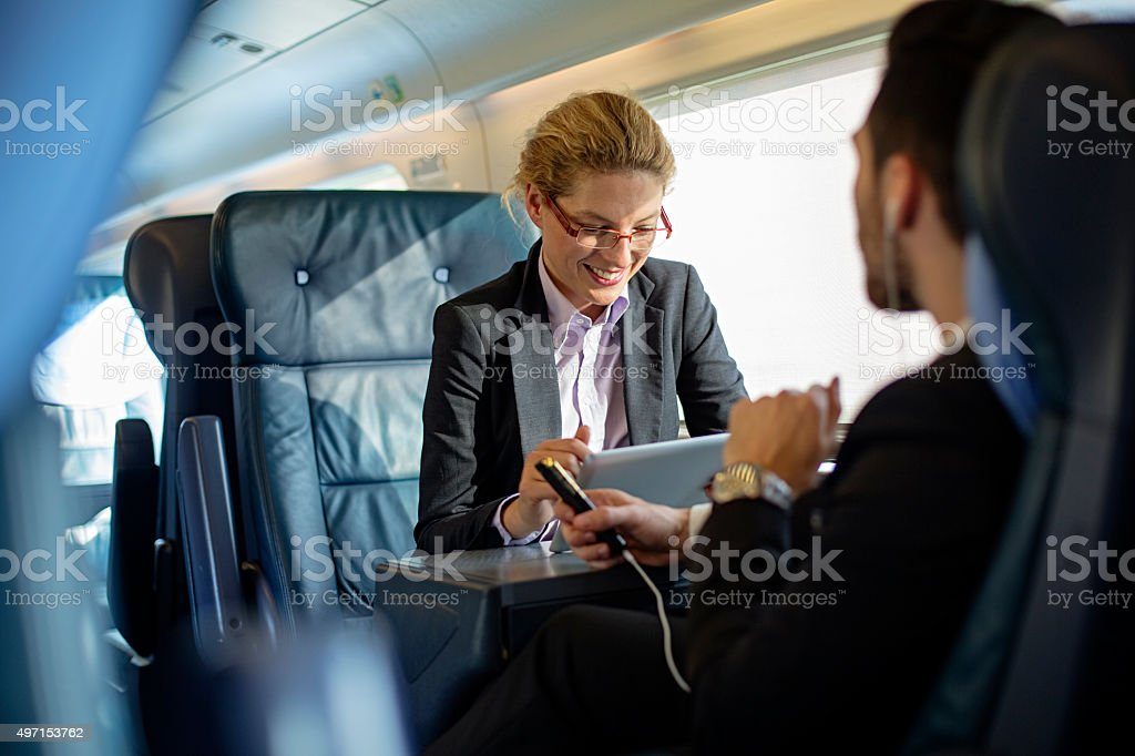 Executives working on train stock photo