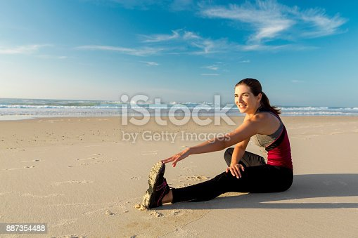 887354516istockphoto Exercise at the beach 887354488