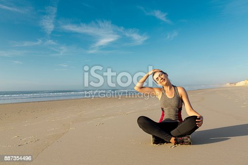 887354516istockphoto Exercise at the beach 887354496