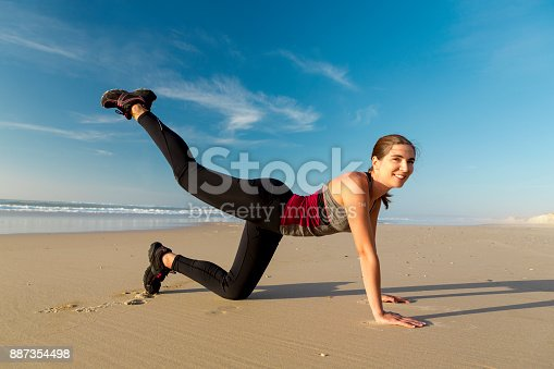 887354516istockphoto Exercise at the beach 887354498