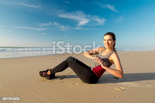 887354516istockphoto Exercise at the beach 887354500