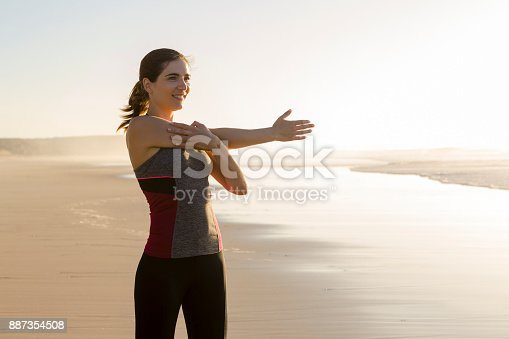887354516istockphoto Exercise at the beach 887354508