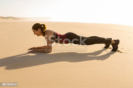 887354516istockphoto Exercise at the beach 887354510