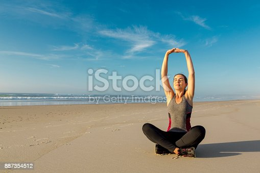 887354516istockphoto Exercise at the beach 887354512