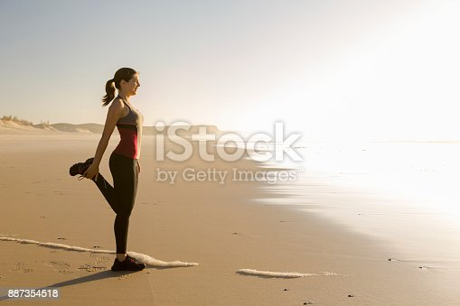 887354516istockphoto Exercise at the beach 887354518