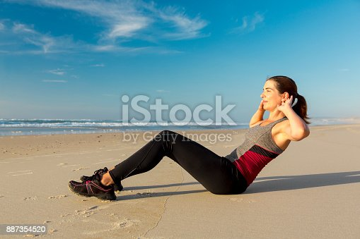 887354516istockphoto Exercise at the beach 887354520