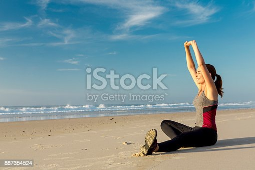 887354516istockphoto Exercise at the beach 887354524