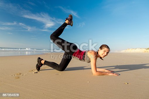 887354516istockphoto Exercise at the beach 887354528