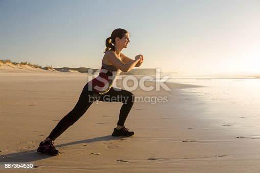 887354516istockphoto Exercise at the beach 887354530