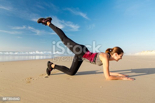 887354516istockphoto Exercise at the beach 887354540