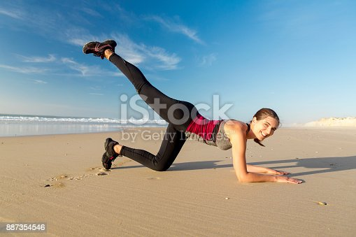 887354516istockphoto Exercise at the beach 887354546