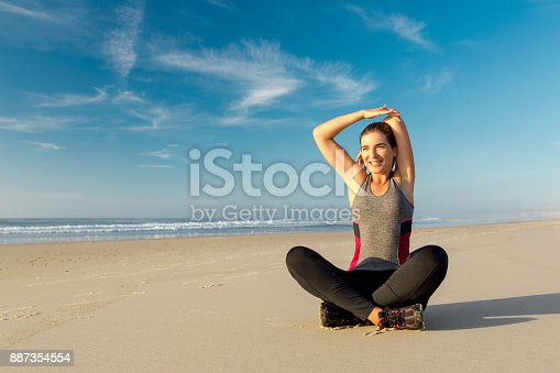 887354516istockphoto Exercise at the beach 887354554
