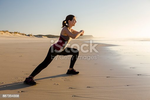 887354516istockphoto Exercise at the beach 887354558