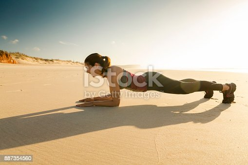887354516istockphoto Exercise at the beach 887354560