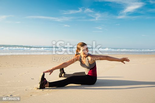 887354516istockphoto Exercise at the beach 887354576