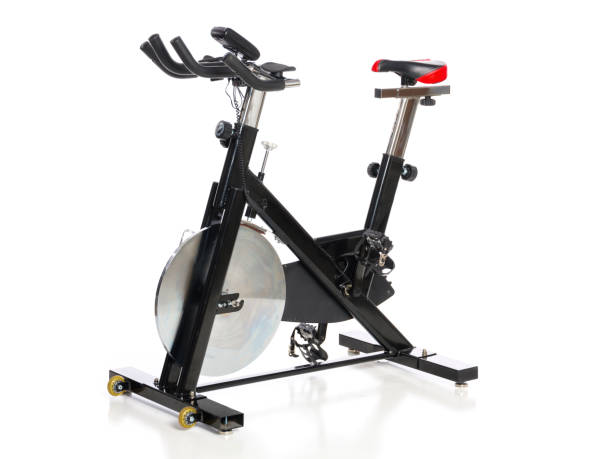 Exercise Bicycle on White Background An exercise bicycle isolated on a white background. exercise bike stock pictures, royalty-free photos & images