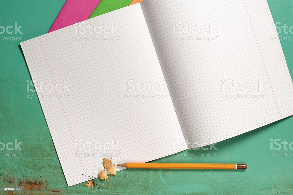 Exercise books and pencils stock photo