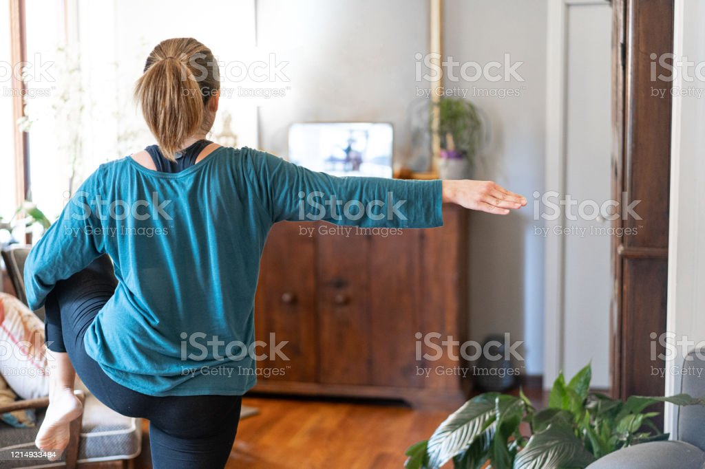exercise breaks Yoga exercise breaks from home Adult Stock Photo