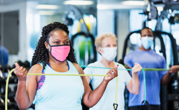 Exercise class in gym, wearing face masks stock photo