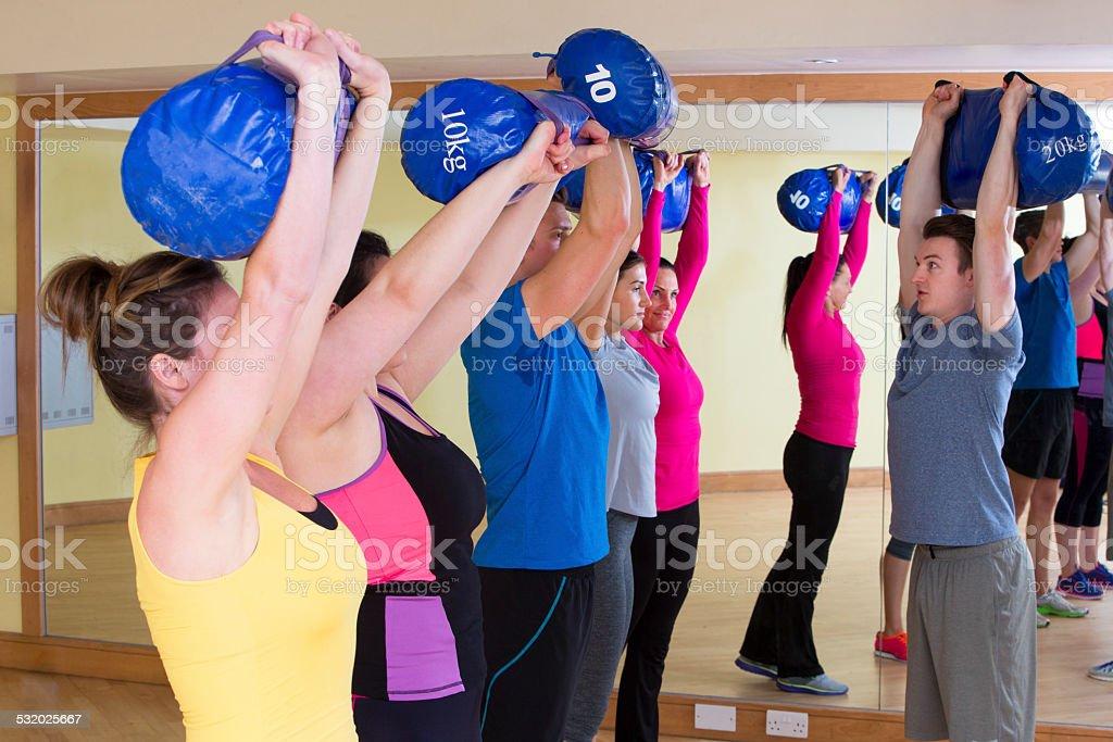 Exercise Class Usng Sandbags stock photo