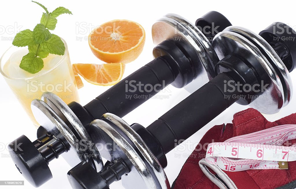 Exercise & Diet -  Dumbbells and Fresh Orange Juice, Isolated royalty-free stock photo