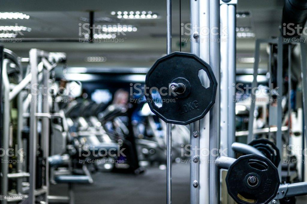 Exercise equipment in empty gym. stock photo