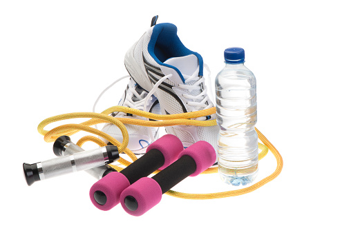 Sport shoes, skipping rope; dumbbells and water bottle isolated on white