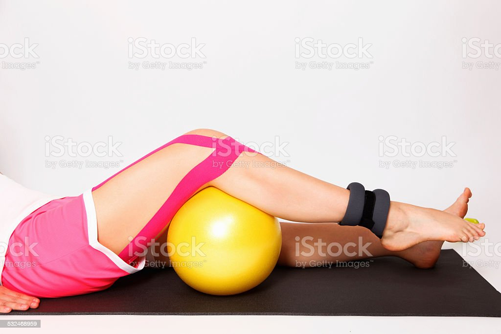 Exercise for injured leg with kinesiology tape stock photo