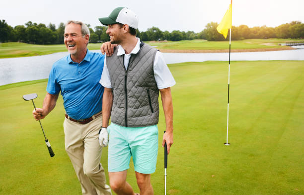 exercise, fresh air, friends and laughter - golf stock photos and pictures