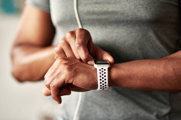 Exercise is more rewarding when you see your numbers in black and white Cropped shot of an unrecognizable man checking his wristwatch fitness tracker stock pictures, royalty-free photos & images