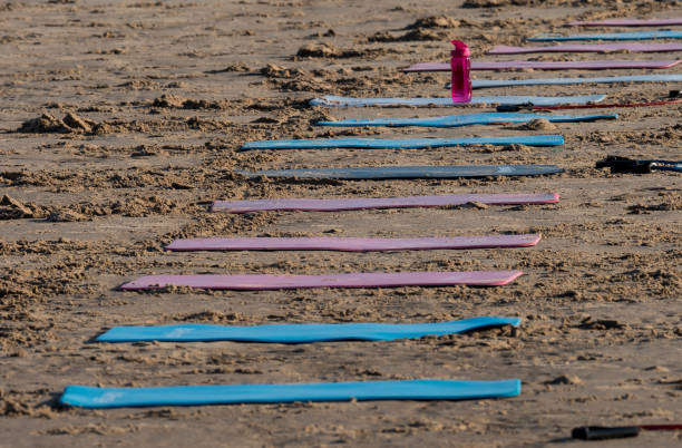 exercise mats on the sand - stephen lynn stock pictures, royalty-free photos & images