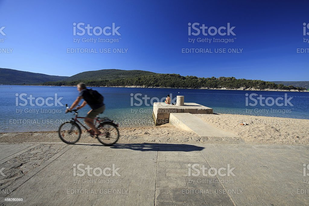 Exercise or relax on the beach? royalty-free stock photo